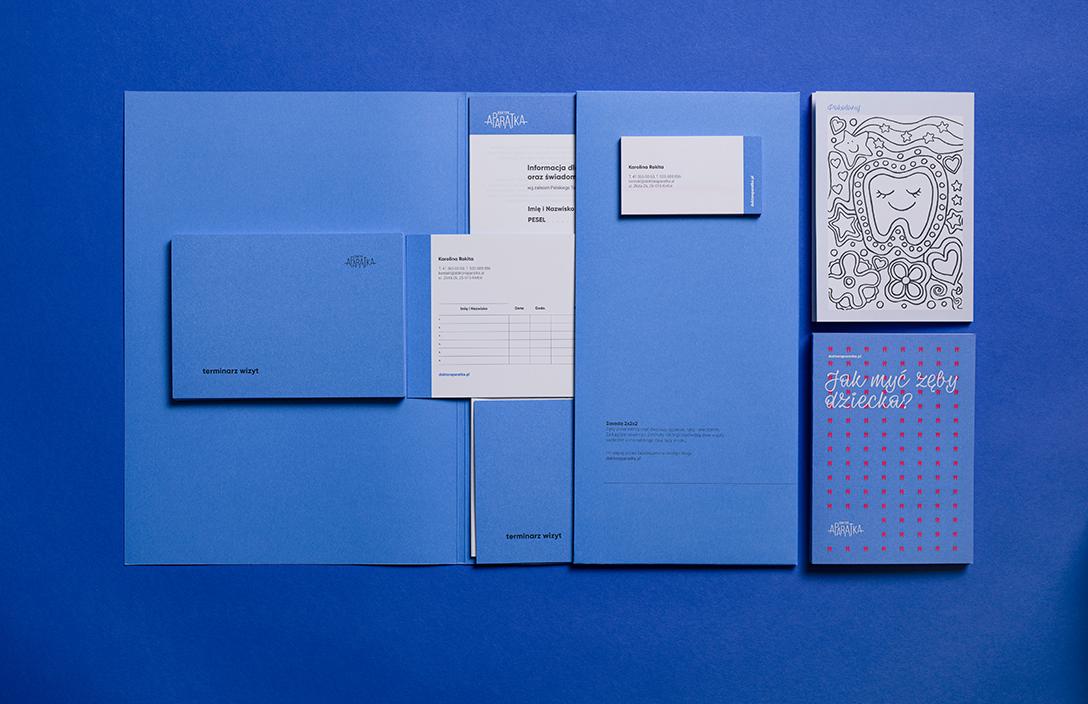 niebieska część identyfikacji teczka, wizytówka, ulotka, kolorowanka, notes zaleceń